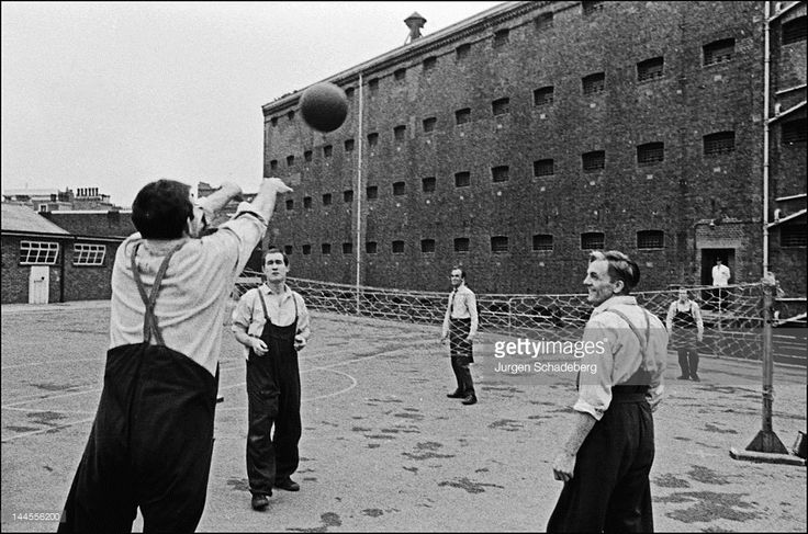 A game of volleyball in Pentonville Prison, London, 1967 by South African photographer Jurgen Schadeberg.
