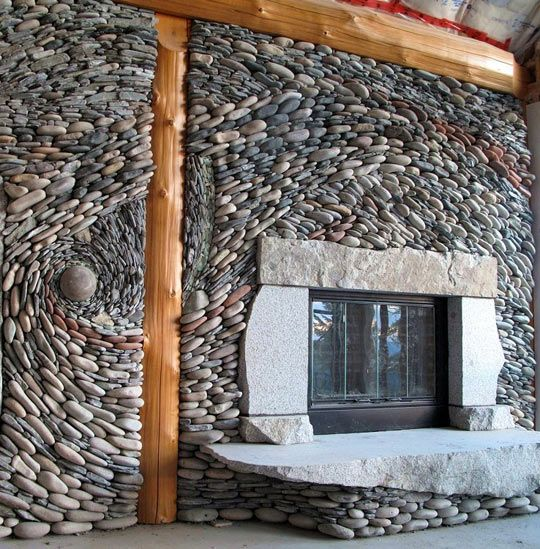 This gives me an idea.  We own property on the Rio Grande River that has beautiful rocks all over; I would love to use some like this on our fireplace wall.