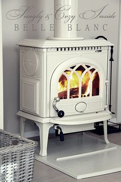 white wood stove - this would look good in front of a ship lap wall