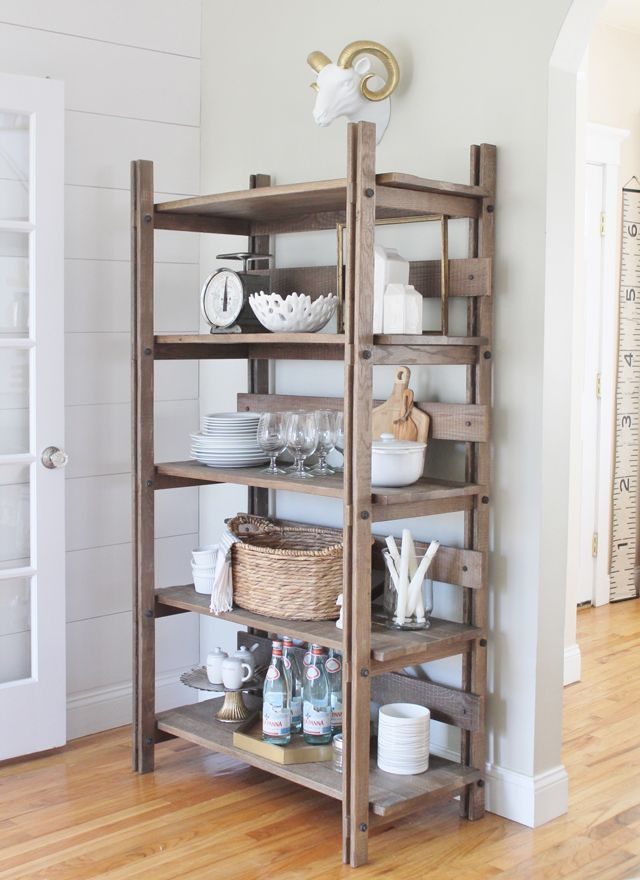 Open shelving in kitchen holds table essentials