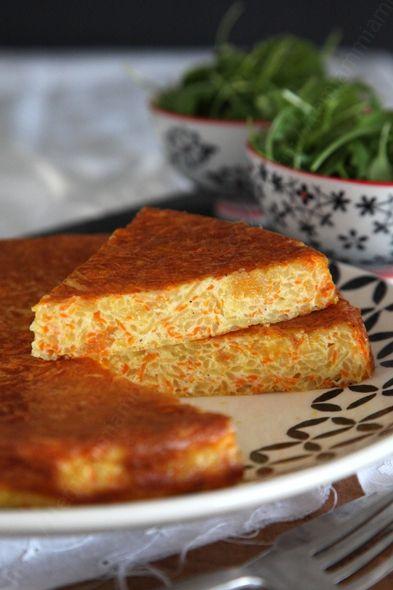 Salé végétarien - Tortilla pommes de terre/carottes. Ingrédients pour 4/6 parts : 1 oignon- 3 carottes- 3 belles pommes de terre- 30 g de beurre doux- huile de tournesol- oeufs entiers- 30 g de mascarpone- 15 cl de crème liquide- Sel et poivre du moulin- 1 pincée de curcuma en poudre- 1 petite pincée de noix de muscade en poudre. Recette sur le site.