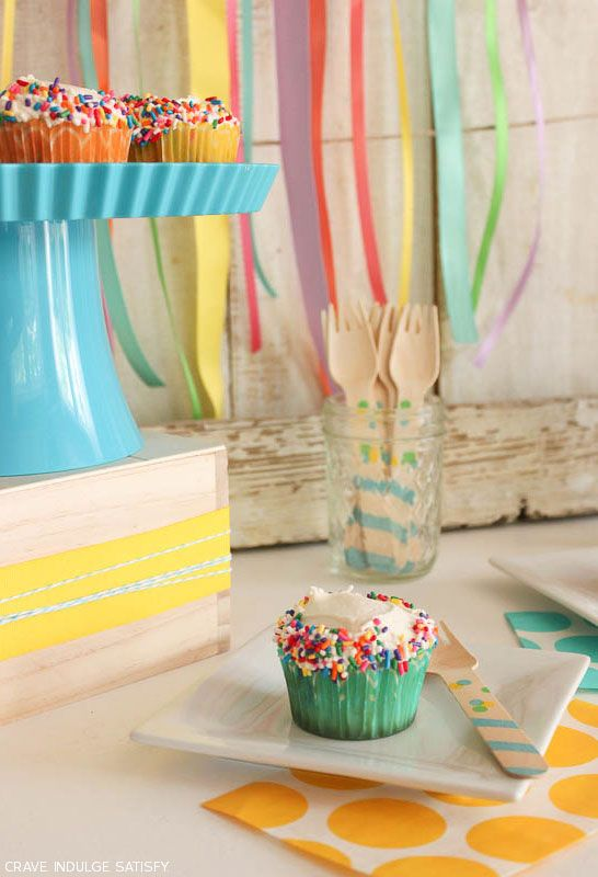 A fun recipe for homemade Funfetti Cupcakes. White cake loaded with rainbow sprinkles, topped with buttercream icing and more sprinkles! A cupcake recipe by Lauren Kapeluck.