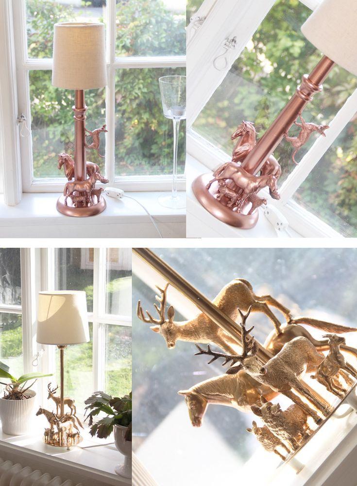 En lampa som är dekorerad med vanliga leksaksdjur och sprayfärg. Jag ska tillverka en grön till min sons rum.