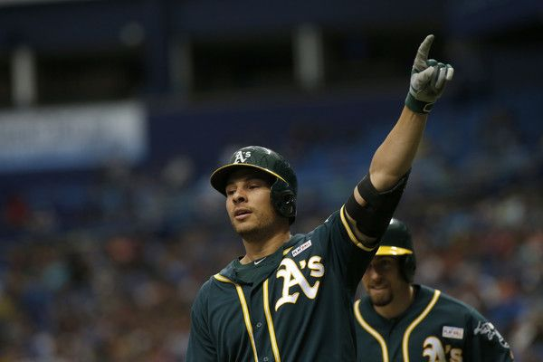 Danny Valencia Photos - Danny Valencia #26 of the Oakland Athletics celebrates his two-run home run during the ninth inning of a game against the Tampa Bay Rays on May 15, 2016 at Tropicana Field in St. Petersburg, Florida. - Oakland Athletics v Tampa Bay Rays