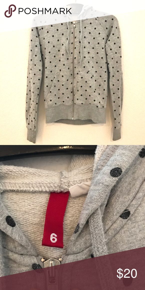 ⚫️Gray and black polka dot hoodie⚫️ ⚫️Gray and black polka dot hoodie⚫️ - Gray hooded sweatshirt with black polka dot pattern printed all over. Perfect for layering or working out.  SIZE: 6 (fits like a women's small)  BRAND: H&M   CONDITION: Very good. No rips or stains. Tops Sweatshirts & Hoodies
