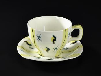 This cream glazed earthenware cup: English, Staffordshire, Burslem, by W.R. Midwinter Ltd, 1950s.