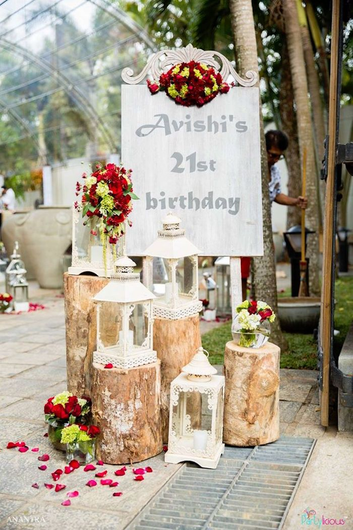 Welcome Sign With Rustic Logs Flower Petals And Lanterns