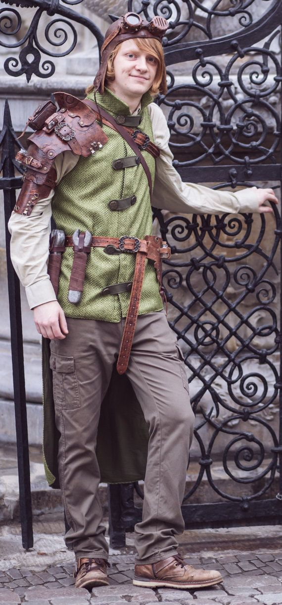 Green steampunk male tail vest with stand-up collar and ornamental fastening with carved antique gold colored buttons. Made of thick woven poliyster with thin cotton lining. Metal buttons are only decorative and vest is fastened with pressbuttons.  Dimensions: Chest: 98cm/39inch Front length: 70cm/27,5inch Back length: 130cm/51inch