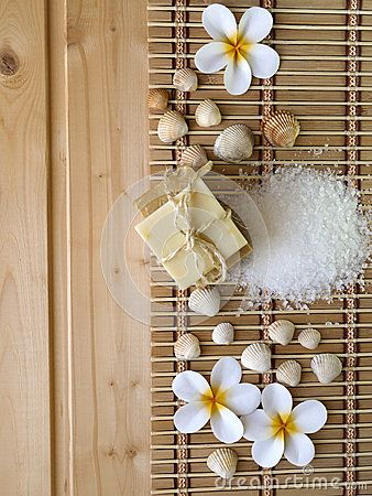 Soap,shells and tiare flowers on the wooden background