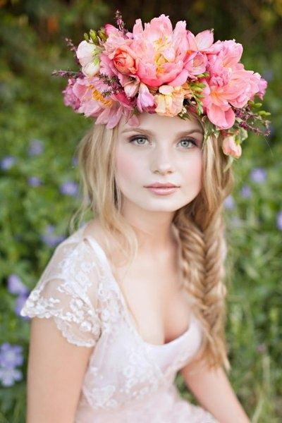 Beautiful shades of pink & peaches in this flower crown compliment the skin tone & fish-bone braided hair. Very natural.
