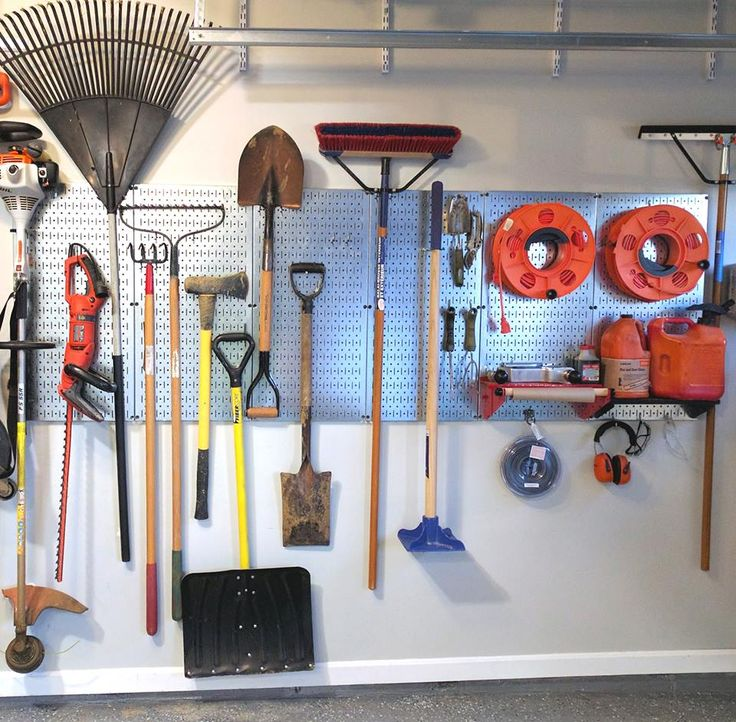Neat and tidy! If your garden tools are all leaned up against each other in some messy corner of your garage, grab some Wall Control metal pegboard and straighten out your mess in style! Thanks for the great photo Mark!