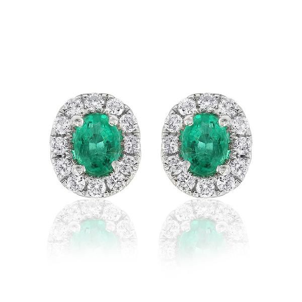 Dazzling Aura earrings featuring a matched pair of oval emeralds surrounded by white diamonds. The Gerard McCabe Aura range features matching earrings, pendants and rings. These earrings are crafted in 18ct white gold and are secured with a post and butterfly clasp. These earrings are 8mm long.