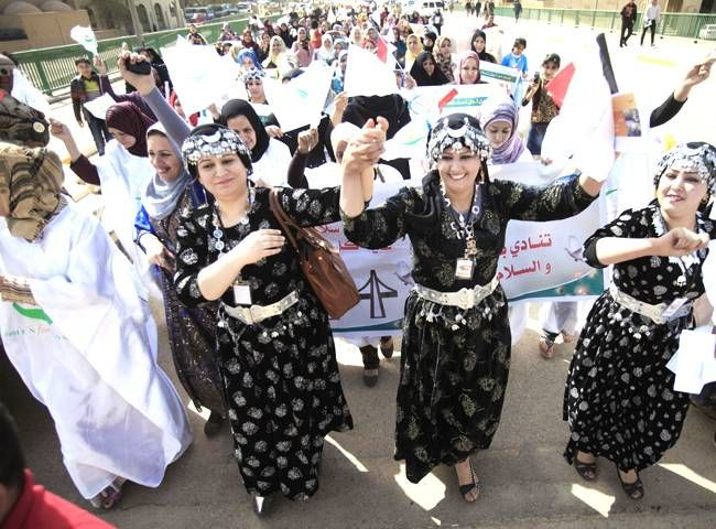 Iraqi women celebrating International Women's Day  I never saw an Iraqi woman's face. Takes real guts to be brave in their culture with the present government.