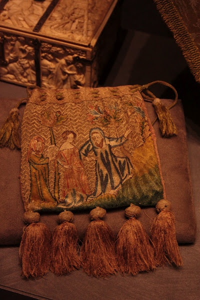 French pouch, ca 1340, embroidered in silk and metal thread, with a lovely row of tassels. It measures approx. 15, 5 * 14,5 cm, height with tassels 21 cm.  Wawel cathedral museum, Krakow, Poland.