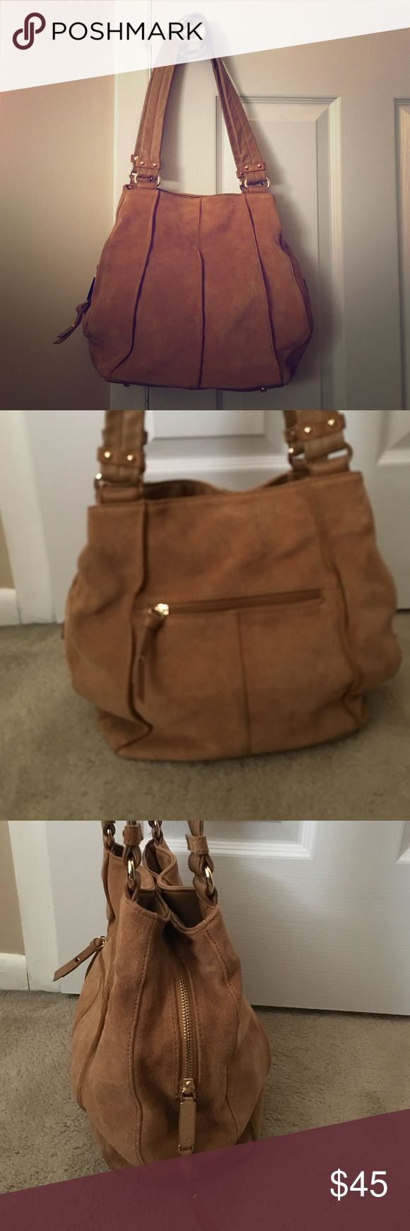 Tignanello handbag Tignanello camel colored suede handbag. Two straps. Main center compartment has zipper. Two large snap compartments that are magnetized. Back has zipper compartment as well. Great condition! Tignanello Bags Shoulder Bags