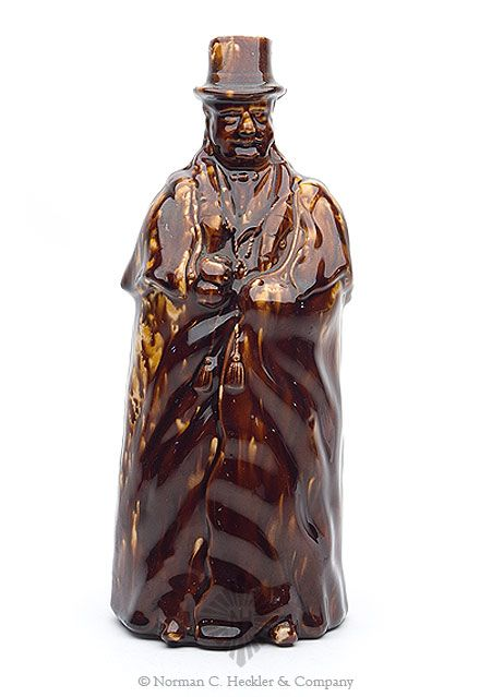 "Figural Pottery Coachman Bottle, Bennington Pottery, circa. 1849. In the form of a heavily cloaked coachman, tan and brown glazes, ht. 10 1/4 inches. Similar to Barret color plate G, bottom row, left Great condition with no repairs to include those sensitive boot tips. This is the extremely rare example with the mustache and tassels. Base marked ""Lyman Fenton & Co / Bennington VT / Fenton's / Ename. Ex Phil Faherty. #Bottles #Figurals #MADonC"