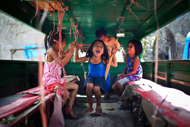 """Joyful: Kids enjoying themselves inside a Jeepney in Cebu City, Philippines."""