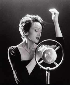 Édith Piaf,  French singer and cultural icon.  Although she was denied a funeral mass by the Roman Catholic archbishop of Paris because of her lifestyle, her funeral procession drew tens of thousands of mourners onto the streets of Paris and the ceremony at the cemetery was attended by more than 100,000 fans.