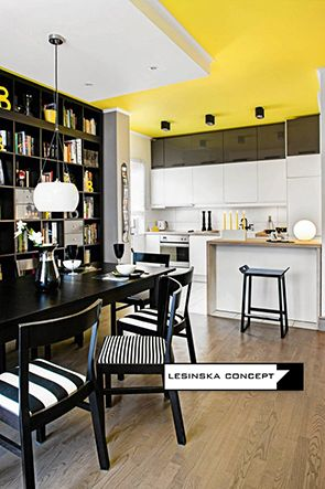 YELLOW, GARY AND BLACK INTERIOR WITH LIGHT WOOD FLOOR