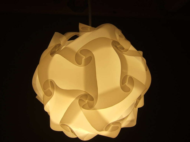 tutorial and template--One simple cut-out shape lets you build all sorts of different designer-looking lampshades.