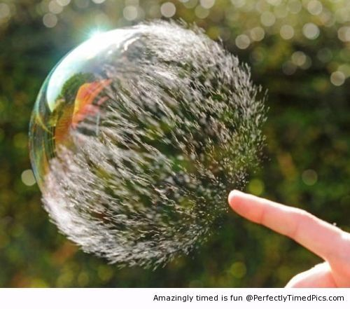 Bubble bursts at the right moment – How a bubble looks when being popped. Perfectly timed.
