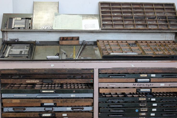 This is a compositors bench. The cases are full of individual movable type, note the upper case top right - above the lower cases, the steel printers rules to measure point sizes, and loads of metal leading spacers. Character filled cases...bad I know.