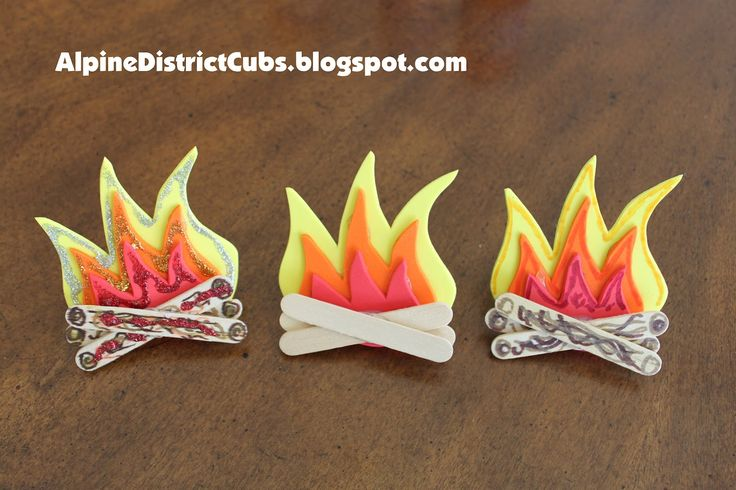 Alpine District Cub Scouts: Campfire neckerchief slides - Core Value Health and Fitness.  It has a PDF you print and use as a guide to cut out the sets of flames.  Super easy and very cute!  All the info on how to make it is here.