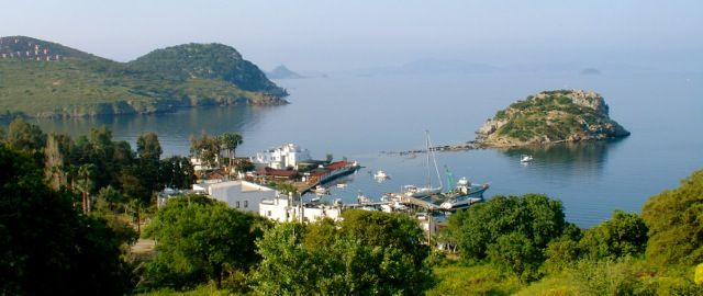 View of Gumusluk Harbour and Rabbit Island from the main road. Beautiful part of Turkey.