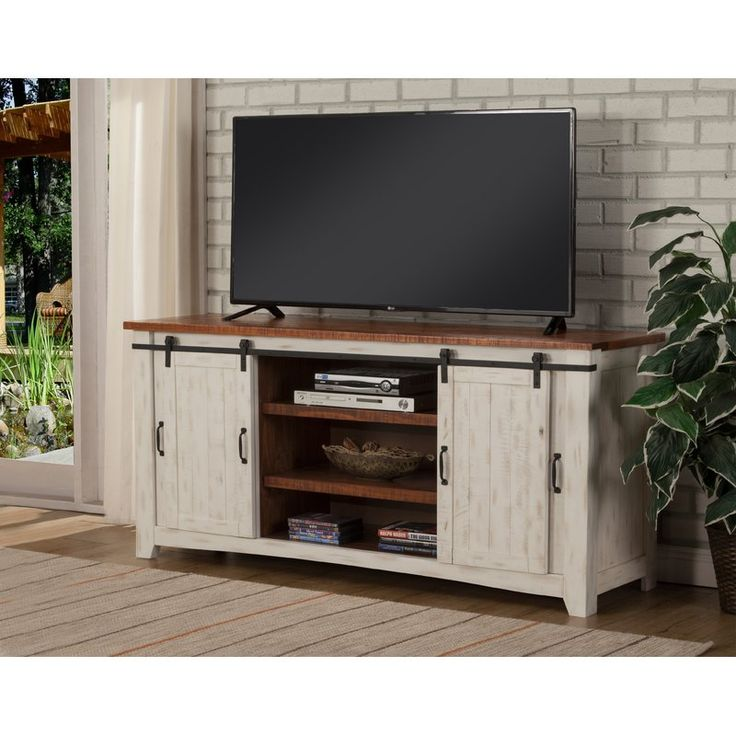 """This Karlo 65"""" TV Stand is a gorgeous rustic style TV Stand. Constructed of solid pine and pine veneers that offers just the right amount of distressing that can blend easily with other rustic, distressed, warehouse, farmhouse or loft looks. The two side doors feature a metal mesh style look that adds to the rustic and distressed look. Four total interior shelves are removable and adjustable providing versatile storage options for audio, video, gaming components. Cable management cut..."""