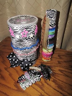 tp roll and oatmeal container headbands on the outside of the oatmeal container and bows and clips inside and tp roll for pony tails
