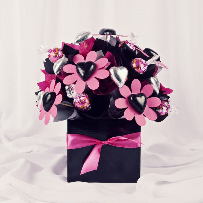 A stunning hot pink and black chocolate bouquet with 30 chocolates including exclusive raspberry lindt balls. Sure to leave her smiling... - Yummy Flowers Brisbane, Florists, North Lakes, QLD, 4509 - TrueLocal