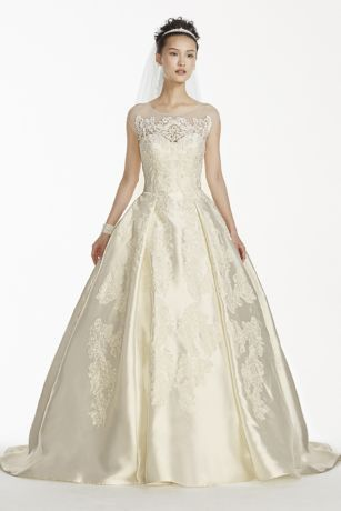 Royalty. That's what you'll exude in this elegant, poised mikado ball gown, which was inspired by none other than the eternally stylish Grace Kelly. Featuring symmetrical scroll lace appliques, an illusion neckline, a chapel train, and those oh-so-desirable pockets, this dress reigns supreme.   Oleg Cassini, exclusively at David's Bridal.  Also available in Regular, Plus Size,Extra Length, and Extra Length Plus Size. Check your local stores for availability.  Chapel train. Fully