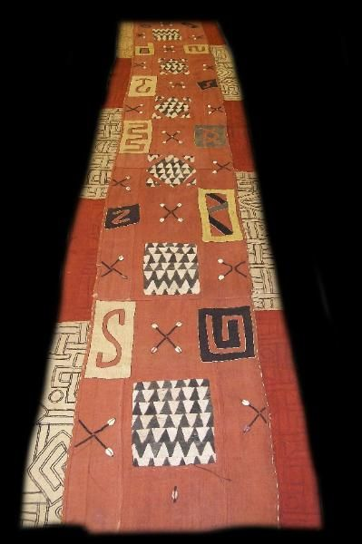 """Kuba skirt - bark cloth incorporated  20.5""""W x 9'L - courtesy of Hamill Gallery  Kuba skirts, more generally known as Kuba cloth, are identified as the long raffia textiles embellished with embroidery and appliqué made in theCongo (Democratic Republic) of Central Africa."""