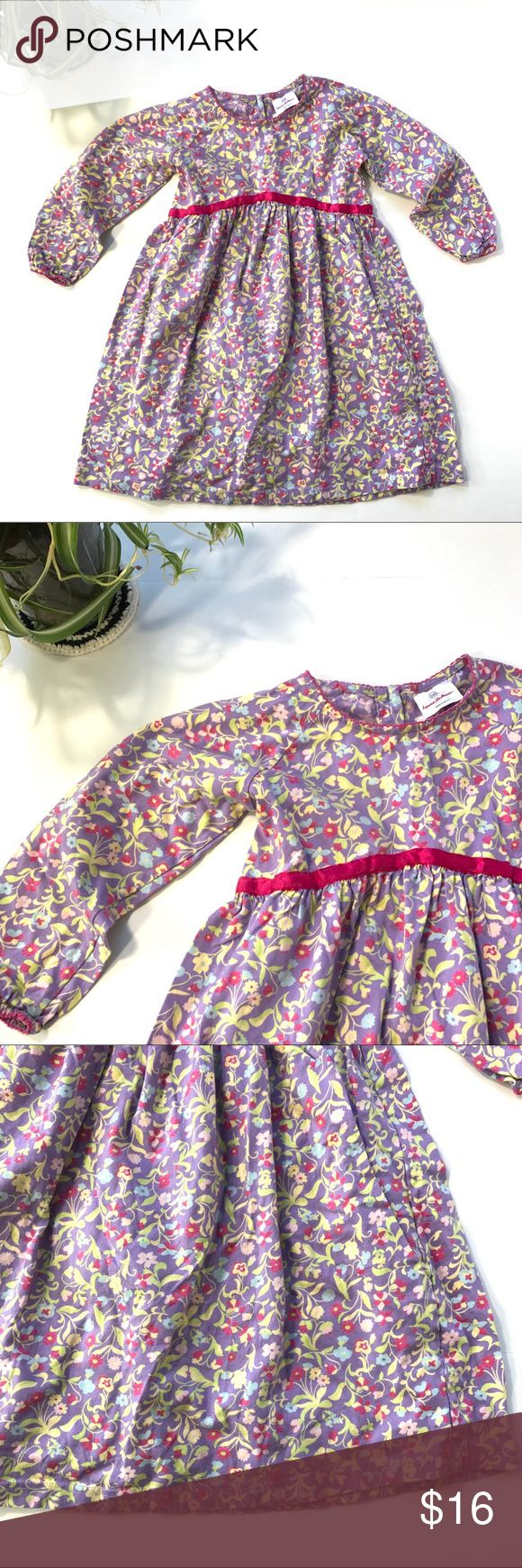 Hanna Andersson purple floral long sleeve dress This is a Hanna Andersson girls floral printed dress with light sleeves and a ribbon waist tie. It is girls size 110 (US 5 equivalent).  This dress is in pre-owned condition with light wear and some light fading, but no holes or stains. Please take a look through the photos to see if this item is right for you! Hanna Andersson Dresses Casual