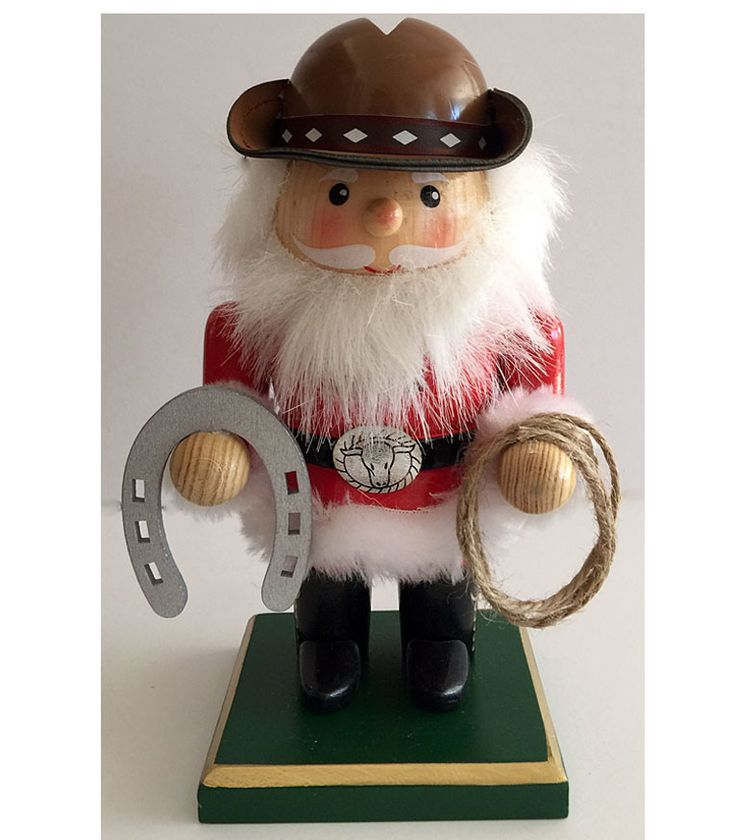 This cowboy Santa nutcracker has one of the cutest faces I've ever seen on a western nutcracker. He reminds me of the Santa in the vintage Rudolph tv special of the 60's. Absolutely a must for the col