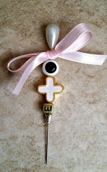 Pink and white baptism pin martyrika with cross initial and evil eye
