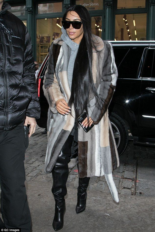Early on Valentine's Day: Kim Kardashian wore her favorite striped fur coat as she stepped...
