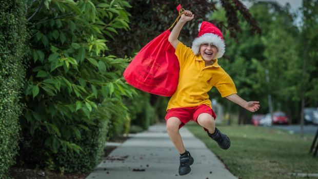 Forrest Primary School student Jumping for the joy he has given - Luca Codina. The six-year-old Canberra boy, who has fundraised to buy Christmas ...