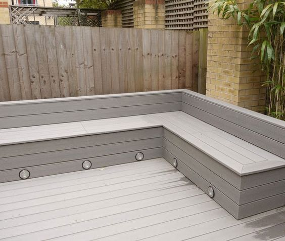 Michael Greenall | Decking in Poole. Corner seating with storage for cushions and built in lighting - Green Thumbing