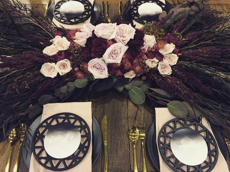 Modern romantic tablescape with David Austin roses and natives