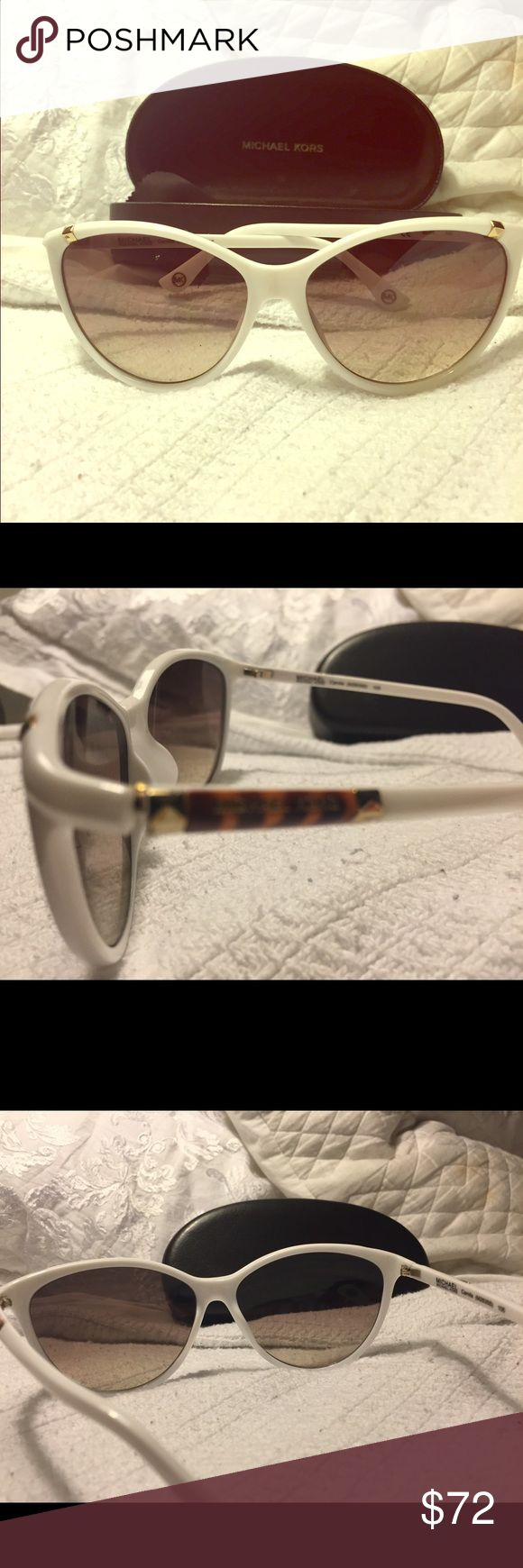 Michael Kors Camila Sunglasses- white Michael Kors Sunglasses are an oversize plastic cat-eye with metal pyramid detailing on the top of the frame and on the temples. The Michael Kors logo is engraved on the temples. Color- white with gold - never worn. Comes with case and cleaning cloth MICHAEL Michael Kors Accessories Sunglasses