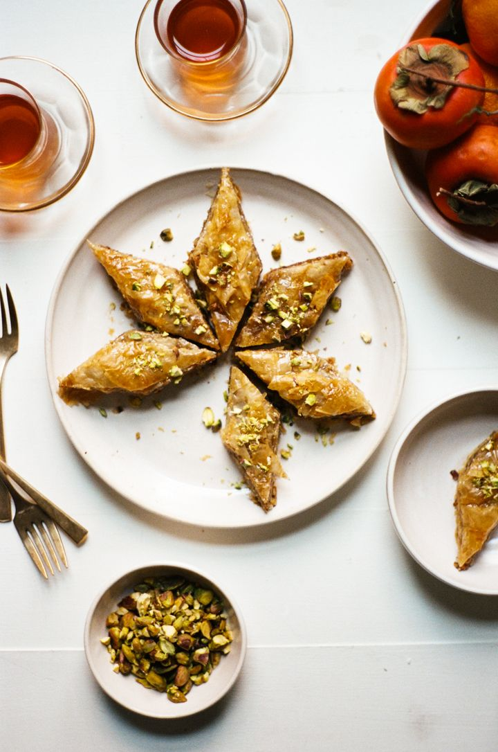 I shared this recipe for baklava scented with the slightest bit of orange flower water (sometimes called orange blossom water) over on my Food52 column last week. I thought you all might like it too so I'm sharing it here. It's such a tasty recipe, and makes a ton of cookies that keep for a while. You can even freeze them! My version of baklava is mostly traditional - packed full of buttery layers of phyllo pastry filled with walnuts and pistachios, but I added a few non-traditional e...