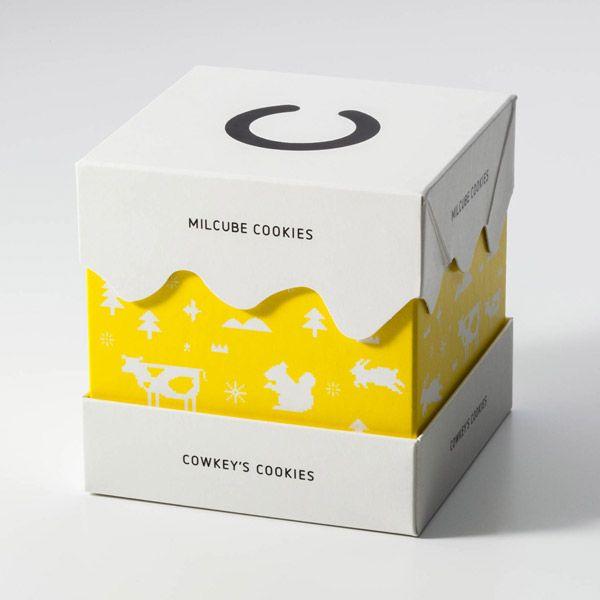 北海道のお菓子やさん「COWKEY'S COOKIES (コーキーズクッキー)」のパッケージ。 雪やクリーム ...