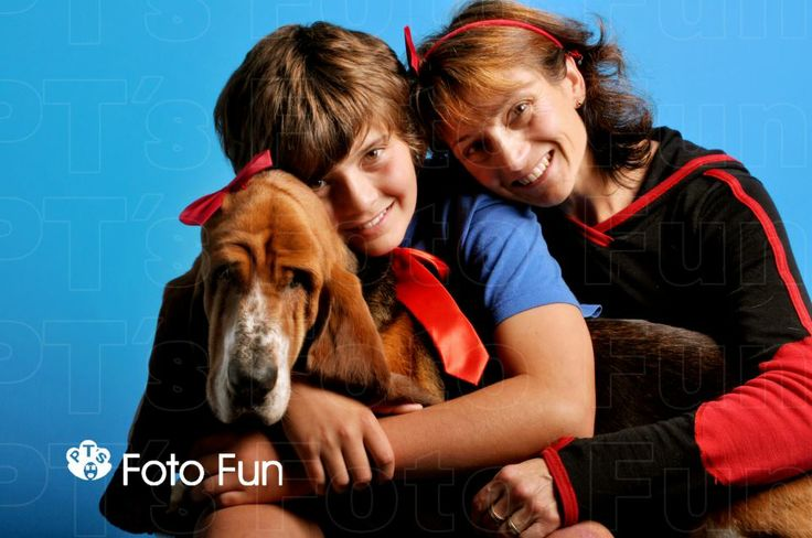 dog with woman and boy, bows
