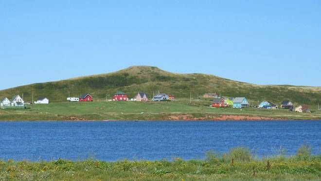 The roads and coastline of the Magdalen Islands are sprinkled with colourfully painted houses. (NADINE FOWNES)