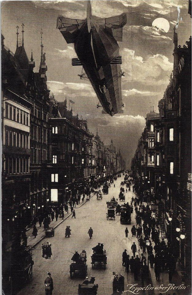Zeppelin over Berlin postcard. https://www.google.co.uk/search?q=Zeppelin+over+Berlin+postcard.&biw=1366&bih=622&source=lnms&tbm=isch&sa=X&ei=4SfjVLLtHeXN7QaEhYHoDg&ved=0CAYQ_AUoAQ