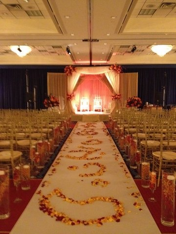 Traditional Indian wedding stage sets, aisle and foyer decor.
