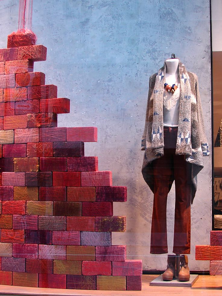 These bricks wrapped in thread are an inexpensive way to bring color and texture to a window display.