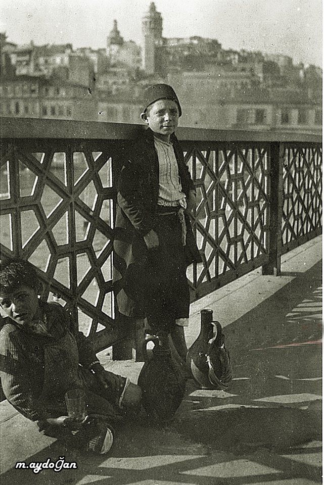 STREET SELLER.  Young water-sellers on the Galata Bridge in Istanbul.  1917.