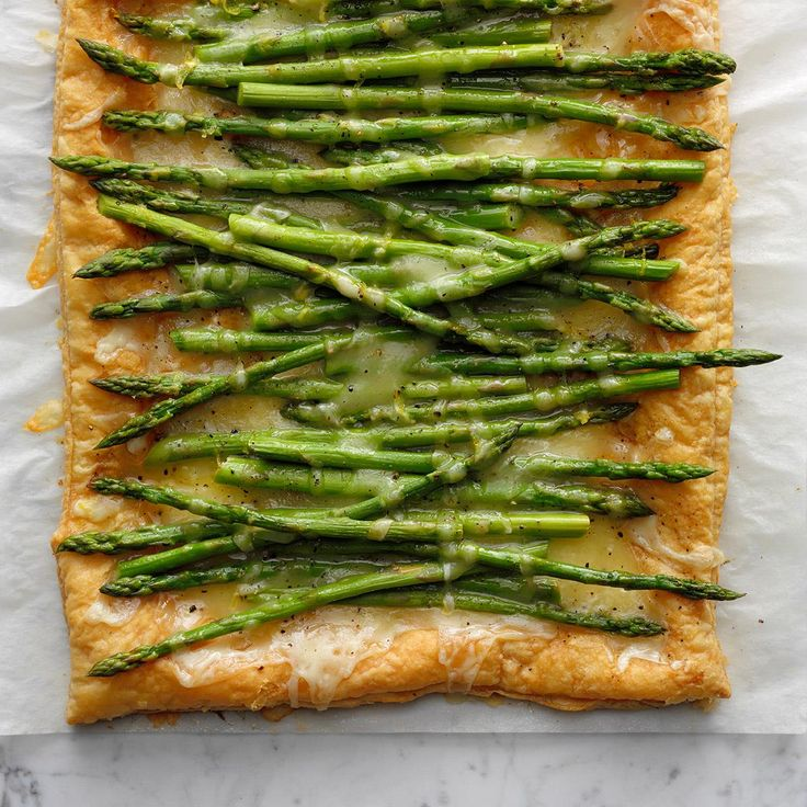 Fontina Asparagus Tart Recipe -This lemony tart is loaded with fontina cheese and fresh asparagus. It's a snap to make but looks really impressive. Be advised…your guests will be vying for the last tasty slice. —Heidi Meek, Grand Rapids, Michigan